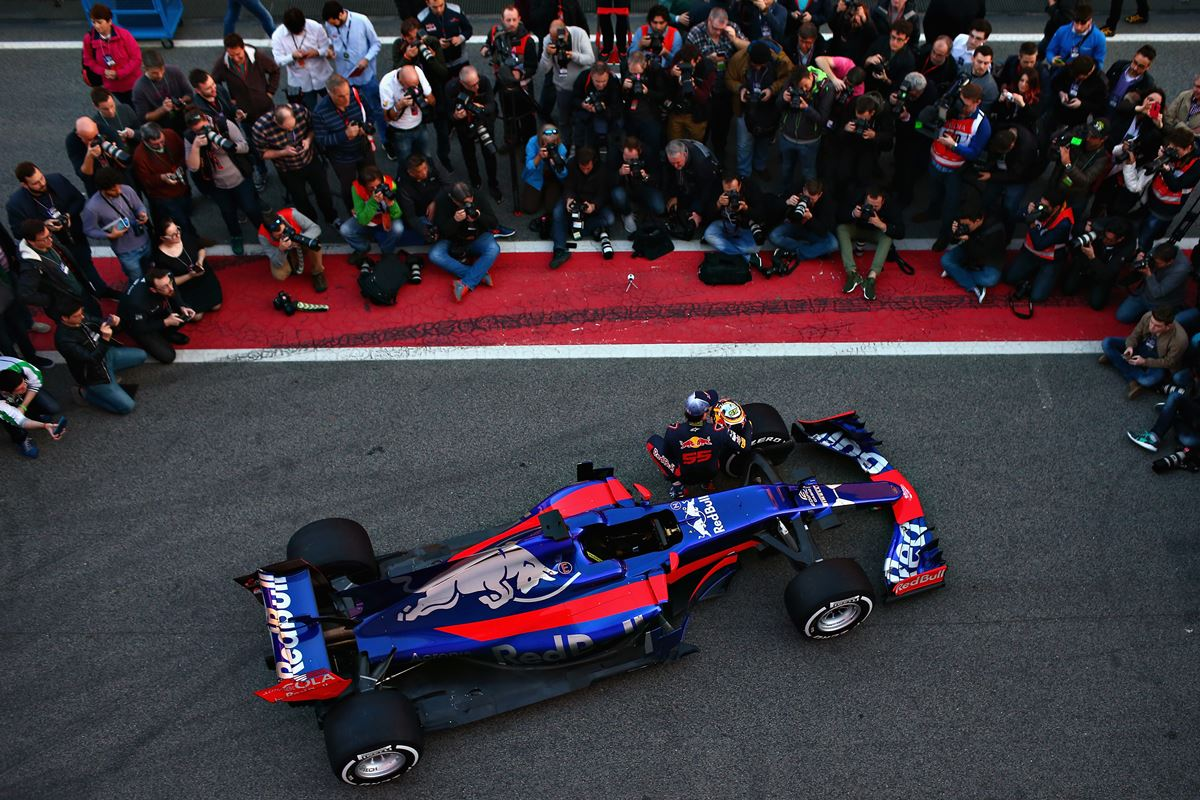 MONTMELO, SPAIN - FEBRUARY 26:  Carlos Sainz of Spain and Scuderia Toro Rosso poses with the Scuderia Toro Rosso STR12 in the Pitlane during previews to F1 winter testing at Circuit de Catalunya on February 26, 2017 in Montmelo, Spain.  (Photo by Dan Istitene/Getty Images)